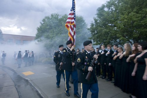 Rick Egan  | The Salt Lake Tribune   The flag is brought to the front through  cloud of smoke, during the 911ceremony in front of the Sandy City Hall, Wednesday, September 11, 2013.