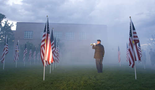 Rick Egan  | The Salt Lake Tribune   A bugler plays taps during the 911ceremony in front of the Sandy City Hall, Wednesday, September 11, 2013.