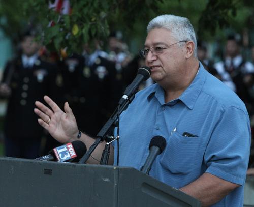 Rick Egan  | The Salt Lake Tribune   Tony Galvez speaks at the 911ceremony in front of the Sandy City Hall, Wednesday, September 11, 2013.