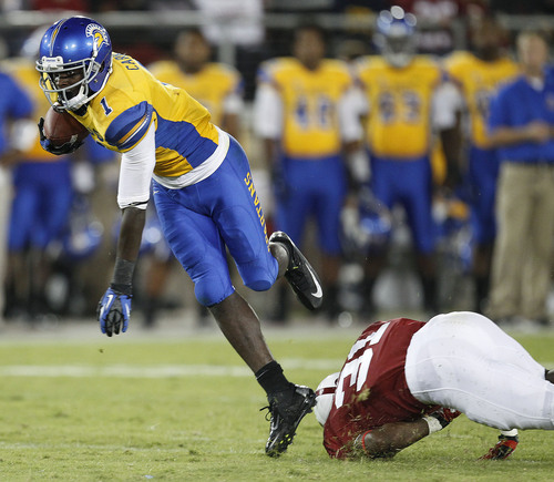 San Jose State wide receiver Jabari Carr (1) leaps over Stanford cornerback Barry Browning (31) for a first down during the second half of an NCAA college football game in Stanford, Calif., Saturday, Sept. 7, 2013. Stanford won 34-13. (AP Photo/Tony Avelar)
