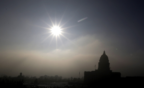 AP file photo The Utah State Capitol is silhouetted against the smog-covered sky on a day last February during an extended inversion.