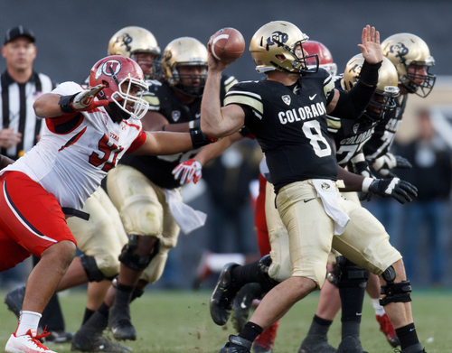 Trent Nelson  |  The Salt Lake Tribune Utah Utes defensive tackle Tenny Palepoi (91) closes in on Colorado Buffaloes quarterback Nick Hirschman (8) as the Colorado Buffaloes host the University of Utah Utes, college football Friday November 23, 2012 in Boulder.