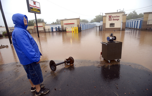 David Platco looks over a flooded and damage storage facility in North Boulder, Colo., on  Thursday, Sept.  12, 2013.  Heavy rains and scarring from recent wildfires sent walls of water crashing down mountainsides early Thursday in Colorado, cutting off mountain towns.  Boulder County was hit hardest, but flooding was reported all along the Front Range, from Colorado Springs to north of Fort Collins. (AP Photo/The Daily Camera, Paul Aiken) NO SALES