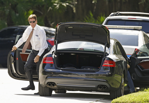 Mark O'Mara, attorney for George Zimmerman, arrives at the scene of a domestic incident in the Lake Mary, Fla. neighborhood where Zimmerman and his wife Shellie had lived during his murder trial, Monday, Sept. 9, 2013. Zimmerman's wife says on a 911 call that her estranged husband punched her father in the nose, grabbed an iPad out of her hand and smashed it and threatened them both with a gun. Zimmerman was recently found not guilty for the 2012 shooting death of Trayvon Martin. (AP Photo/John Raoux)