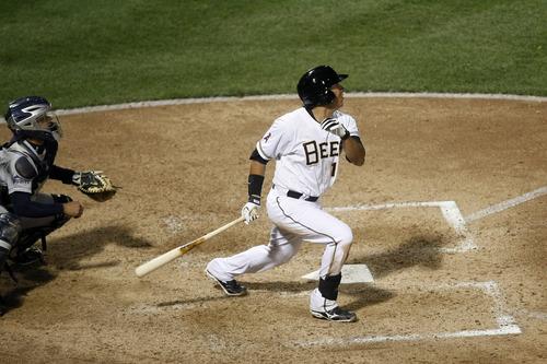 Chris Detrick  |  The Salt Lake Tribune Salt Lake Bees' Efren Navarro (16) hits a three-run RBI in the bottom of the seventh inning during the game at Spring Mobile Ballpark Thursday April 4, 2013. ]