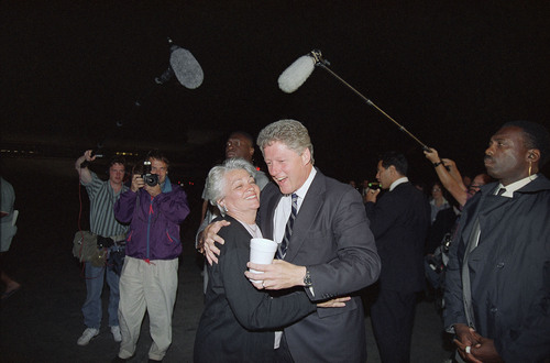 Democratic presidential candidate Gov. Bill Clinton is all smiles as he shares a welcoming hug with Norma Matheson, the wife of the late Utah governor Scott Matheson, upon Clinton's arrival at the Salt Lake City airport in Utah on Monday, Sept. 15, 1992. Clinton was in town to address members of the 114th General Conference of the National Guard Association of the U.S. on Tuesday. (AP Photo/George Frey)