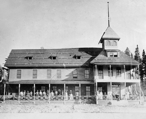 "Salt Lake Tribune archive  Hotel at Arrange, Idaho at the entrance to Yellowstone Park, where J.N. ""Six-shooter Newt"" Adams and his wife worked when first married. Adams was an explorer and entrepreneur, as well as the first white (non-Native American) child born in SE Idaho."