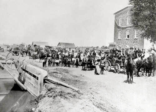 Salt Lake Tribune archive  A parade, complete with a brass band in the lead wagon, passes in front of the grist mill in Menan, Idaho around 1900.