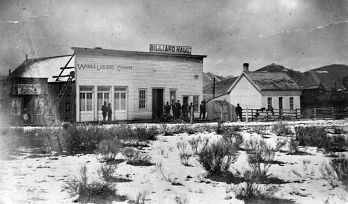 Salt Lake Tribune archive  Dillon St. in Soda Springs, Idaho in 1882 when the first Union Pacific locomotive arrived in town. The large building on the left was a saloon and billiards hall. The small building on the right was a Chinese restaurant.