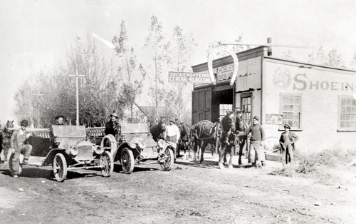 """Salt Lake Tribune archive  Blacksmith shop owned by J.N. """"Six-shooter Newt"""" Adams in Rigby, Idaho. circa 1900. Adams was the first white (non-Native American) child born in what is now Jefferson County, Idaho. During his lifetime he was an entrepreneur, outfitter and explorer, an Army guide and he broke horses for both stage companies and the Army during the Spanish American war. He also established the first Idaho Pioneer Day independent from Utah in 1916."""