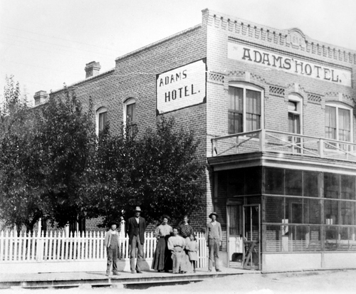 """Salt Lake Tribune archive  Adams Hotel in Market Lake, Idaho in 1892. The hotel was owned by J.N. """"Six-shooter Newt"""" Adams. """"Six-shooter"""" was the first white (non-Native American) child born in what is now Jefferson County, Idaho. During his lifetime he was an entrepreneur, outfitter and explorer, an Army guide and he broke horses for both stage companies and the Army during the Spanish American war. He also established the first Idaho Pioneer Day independent from Utah in 1916."""