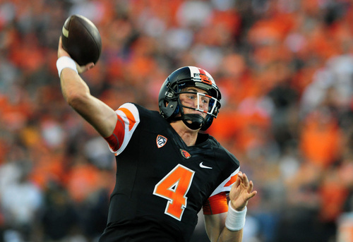 Oregon State quarterback Sean Mannion (4) throws a touchdown pass in the third quarter of the NCAA college football game against Hawaii in Corvallis, Ore., Saturday, Sept. 7, 2013. (AP Photo/Steve Dykes)
