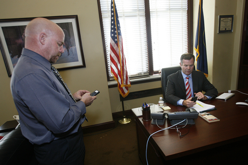 Scott Sommerdorf   |  The Salt Lake Tribune Utah Attorney General John Swallow confers with his spokesman, Paul Murphy, left, in his office on the day it was announced the U.S. Department of Justice will not prosecute him, Thursday, September 12, 2013.