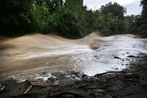 Boulder Creek roils at high speed after days of record rain and flooding, at the base of Boulder Canyon, Colo., Friday Sept. 13, 2013 in Boulder. People in Boulder were ordered to evacuate as water rose to dangerous levels amid a storm system that has been dropping rain for a week. Rescuers struggled to reach dozens of people cut off by flooding in mountain communities, while residents in the Denver area and other areas were warned to stay off flooded streets. (AP Photo/Brennan Linsley)
