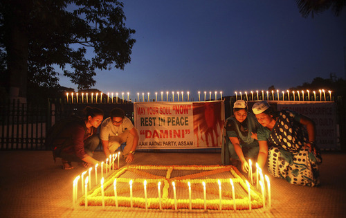 People light candles in Gauhati, India on Friday, Sept. 13, 2013, to mark the verdict after a judge pronounced death sentences for four men convicted in the rape and murder of a student on a moving bus in New Delhi last year. A judge on Friday ordered all four to the gallows for a brutal attack that left the young woman with such severe internal injuries that she died two weeks later. (AP Photo/Anupam Nath)