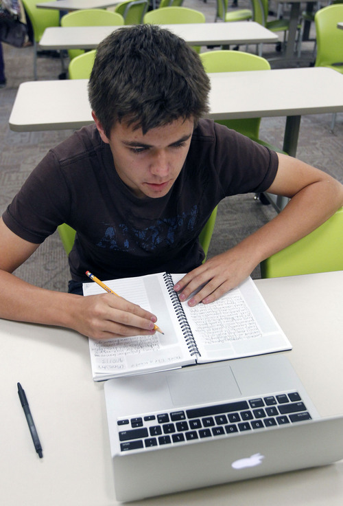 Al Hartmann  |  The Salt Lake Tribune Sophomore Christian Udy looks over chemistry notes. He is one of 175 students at Kaysville's Career Path High to receive a laptop under the Smart Schools program, which splits the bill for such tecnology with about ten Utah schools.