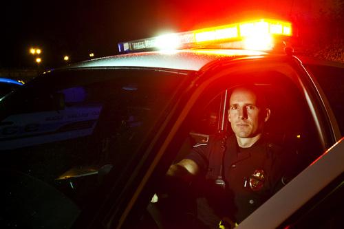 Chris Detrick  |  The Salt Lake Tribune West Valley City Patrol Officer Jacob Hill poses for a portrait Thursday September 12, 2013.