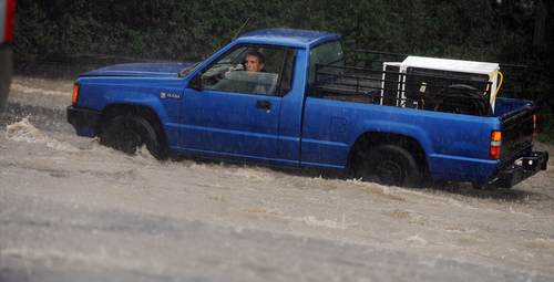 A man looked out the window of his truck after it stalled in rising water in Colorado Springs, Colorado, on Sunday, Sept. 15, 2013.  Many streets were flooded with rainwater during several heavy storms. (AP Photo/The Gazette, Jerilee Bennett)