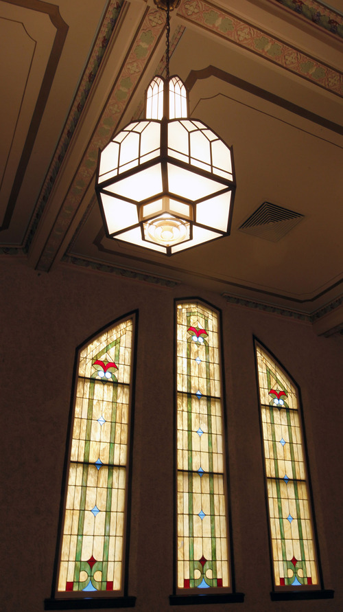 Al Hartmann     The Salt Lake Tribune Stained glass windows and Italian chandeliers grace the chapel of an old LDS Church at 2115 Jefferson Ave. in Ogden under restoration. It first opened in 1937.