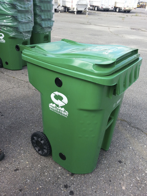 "Black vents improve the decomposition of grass clippings and other organic materials in bright green cans which the Wasatch Front Waste and Recycling District will start using next year, on a subscription basis, to collect ""green waste."""