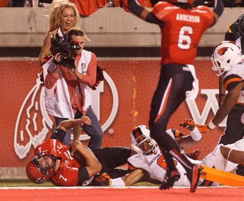 Trent Nelson  |  The Salt Lake Tribune Utah Utes quarterback Travis Wilson (7) scores his first fourth quarter touchdown as the University of Utah hosts Oregon State, college football at Rice Eccles Stadium Saturday, September 14, 2013 in Salt Lake City.