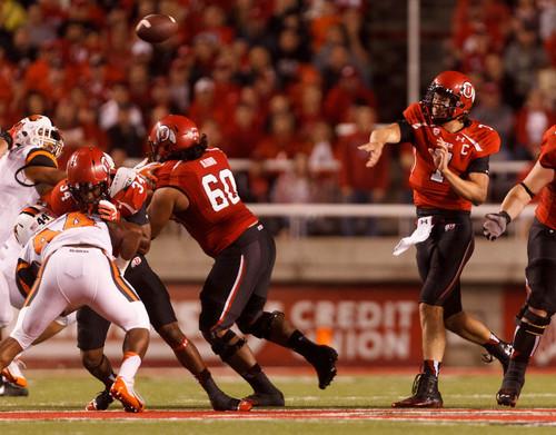 Trent Nelson  |  The Salt Lake Tribune Utah Utes quarterback Travis Wilson (7) passes the ball as the University of Utah hosts Oregon State, college football at Rice Eccles Stadium Saturday, September 14, 2013 in Salt Lake City.