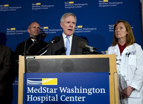 Secretary of the Navy Ray Mabus  speaks during a news conference at Washington Hospital Center, in Washington, Monday, Sept. 16, 2013, after he visited those injured at the shooting at Navy Yard building. With him at right is chief operating officer Dr. Janis M. Orlowski and Adm. Jonathan Greenert. (AP Photo/Jose Luis Magana)