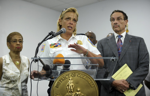 District of Columbia Police Chief Cathy Lanier, center, flanked by Rep. Eleanor Holmes Norton, D-D.C., left, and District of Columbia Mayor Vincent Gray, right, briefs reporters on the shooting at the Washington Navy Yard in Washington, Monday, Sept. 16, 2013. (AP Photo/Susan Walsh)