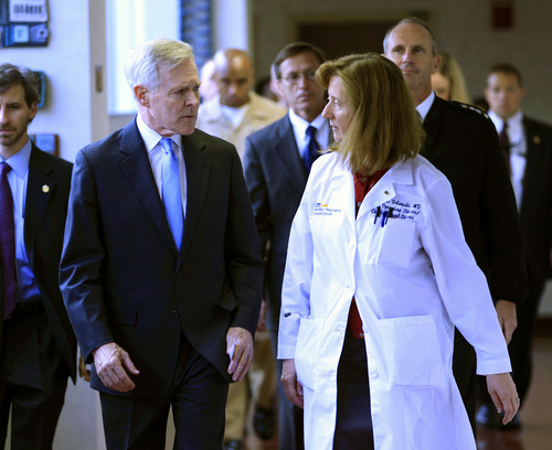 Secretary of the Navy Ray Mabus speaks with Dr. Janis M. Orlowski as they walk in the corridor at Washington Hospital Center, in Washington, on Monday, Sept. 16, 2013, after visiting the people injured in the shooting at the Washington Navy Yard. At least one gunman launched an attack inside the Washington Navy Yard, spraying gunfire on office workers in the cafeteria and in the hallways at the heavily secured military installation in the heart of the nation's capital, authorities said. (AP Photo/Jose Luis Magana)