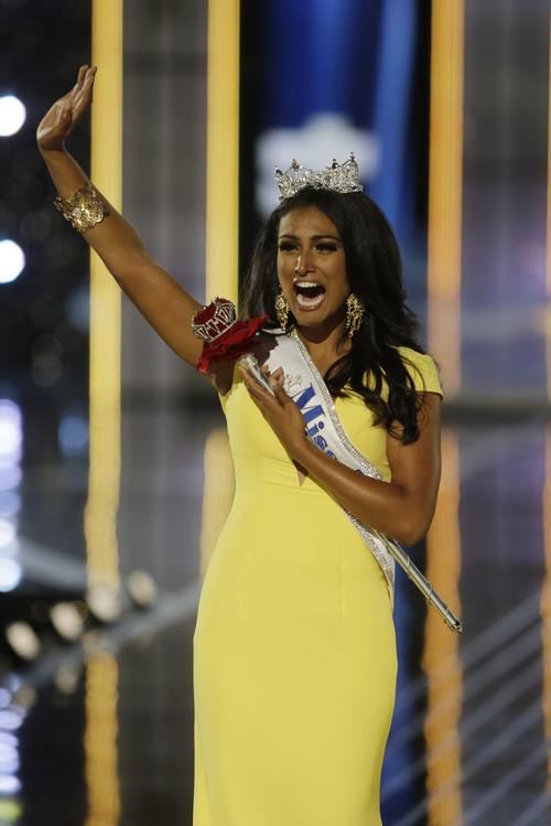 Miss New York Nina Davuluri walks down the runway after winning the the Miss America 2014 pageant, Sunday, Sept. 15, 2013, in Atlantic City, N.J. (AP Photo/Mel Evans)