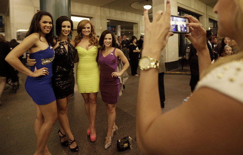 Miss America pageant alumni, from left, Miss Nebraska Mariah Cook, Miss Nevada Randi Sundquist, Miss Alabama Anna Laura Bryan, and Miss South Dakota Calista Kirby pose for a photograph before the Miss America 2014 pageant, Sunday, Sept. 15, 2013, in Atlantic City, N.J. The former misses participated in last year's contest in Las Vegas. (AP Photo/Julio Cortez)