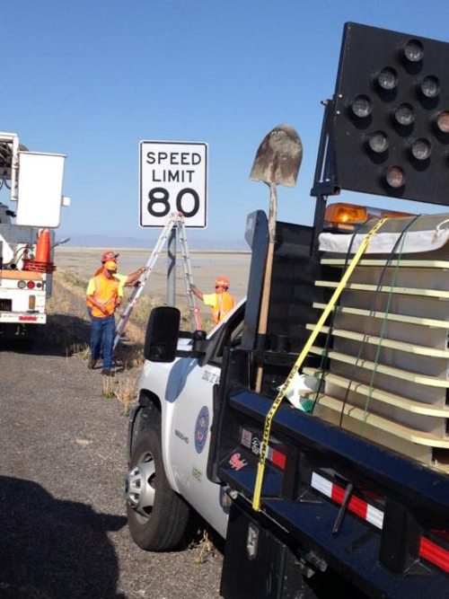 | Courtesy UDOT Utah Department of Transportation crews install new 80 mph speed zone signs west of Tooele. Utah has just added 289 extra miles of 80 mph speed zones.