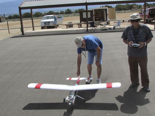 Tom Wharton     The Salt Lake Tribune Glenn Evans and Arnold Vitarbo prepare a radio-control model airplane for takeoff.