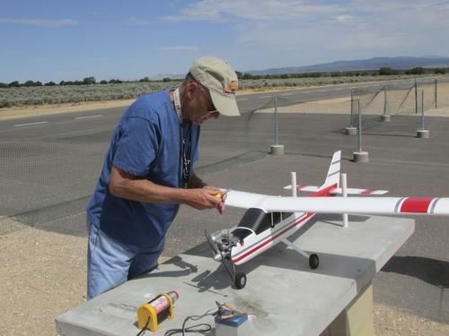 Tom Wharton     The Salt Lake Tribune Glenn Evans of Cedar City starts up a model airplane at Three Peaks Modelport Field.
