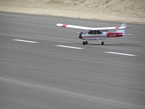 Tom Wharton     The Salt Lake Tribune A model airplane lands at the Three Peaks Modelport Field northwest of Cedar City.