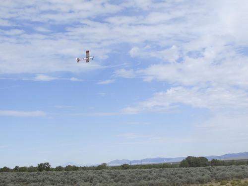 Tom Wharton     The Salt Lake Tribune A  radio-control airplane soars high over the new Three Peaks Modelport Field northwest of Cedar City.