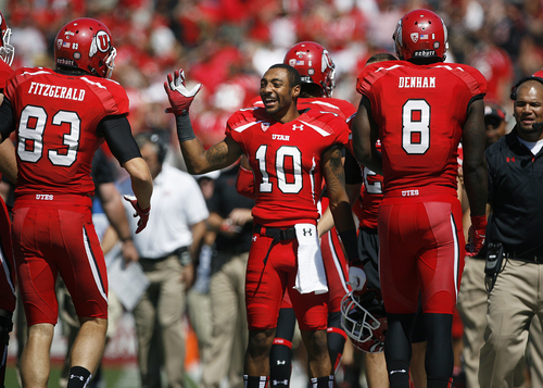 Scott Sommerdorf   |  The Salt Lake Tribune Utah Utes wide receiver Delshawn McClellon (10) congratulates Utah WR Sean Fitzgerald (83) after Fitzgerald's 80 yard TD catch and run. Utah cruised to a 49-0 halftime lead over Weber State, Saturday, September 7, 2013.
