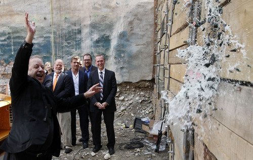 Al Hartmann  |  The Salt Lake Tribune The Very Reverend Rick Lawson throws a champaign botle against retaining wall for the  groundbreaking and christening of the Jessie Eccles Quinney Center for Dance and renovation of the Janet Quinney Lawson Capitol Theatre at 50 West 200 South in Salt Lake City Monday September 16.