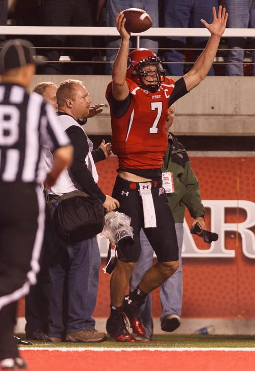 Trent Nelson  |  The Salt Lake Tribune Utah Utes quarterback Travis Wilson (7) celebrates his first fourth quarter touchdown as the University of Utah hosts Oregon State, college football at Rice Eccles Stadium Saturday, September 14, 2013 in Salt Lake City.