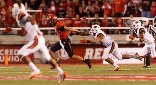 Trent Nelson  |  The Salt Lake Tribune Utah Utes quarterback Travis Wilson (7) runs the ball as the University of Utah hosts Oregon State, college football at Rice Eccles Stadium Saturday, September 14, 2013 in Salt Lake City.