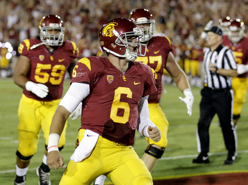 Southern California quarterback Cody Kessler celebrates his touchdown against Washington State during the first half of an NCAA college football game in Los Angeles, Saturday, Sept. 7, 2013. (AP Photo/Chris Carlson)