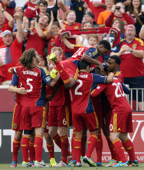 Steve Griffin | The Salt Lake Tribune  Real Salt Lake's players pile on teammate Alvaro Saborio after Saborio scored the games first goal during first half action of the RSL vs. Portland U.S. Open Cup semifinals soccer game at Rio Tinto Stadium in Sandy, Utah Wednesday August 7, 2013.