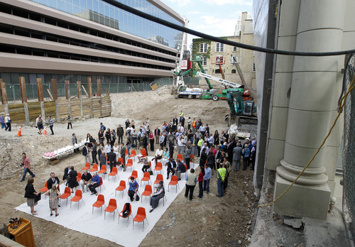 Al Hartmann  |  The Salt Lake Tribune Salt Lake City and  Salt Lake County officials and art and ballet benefactors gather in a 12 foot excavated hole in the ground for a groundbreaking and christening of the Jessie Eccles Quinney Center for Dance and renovation of the Janet Quinney Lawson Capitol Theatre at 50 West 200 South in Salt Lake City Monday September 16.