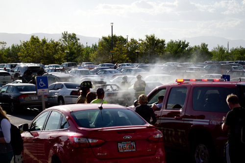 A car caught ire in a UVU parking lot on Sept. 17, 2013, spreading the blaze to 7 other vehicles. No injuries were reported. Photo courtesy of Alex Sousa for the UVU Review.