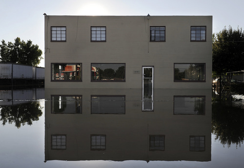 A building is surrounded by floodwaters in Loveland, Colo., on Monday, Sept. 16, 2013. Floodwaters have affected a 4,500 square-mile section of the state inundating entire neighborhoods and destroying bridges and roads. (AP Photo/Chris Schneider)