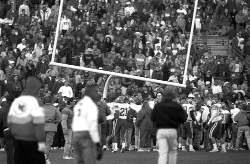Photo courtesy Mark A. Philbrick/BYU  Utah players are seen gathered around a goal post they attempted to pull down after Chris Yergensen (11) kicked a 55-yard field goal to beat BYU in Provo on November 20, 1993.