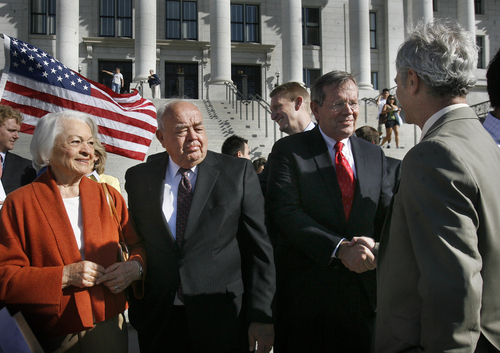 "Scott Sommerdorf  |  The Salt Lake Tribune Norma Matheson, left, former Utah Governor Norm Bangerter, center, look on as former Utah Governor Mike Leavitt greets Salt Lake City Mayor Ralph Becker, far right, on the south steps of the State Capitol building on Wednesday. They were all on hand to support the ""Count My Vote"" effort on the south steps of the State Capitol building."