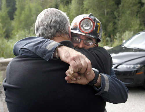 Bodee (cq) Allred, Crandall Canyon Mine Safety Director, right, is barely able to wrap his arms around the big shoulders of Emery County Sheriff LaMar Guymon  for a hug of support at the command center in Huntington Canyon Wed. afternoon.  Al Hartmann/Salt Lake Tribune  8/15/07