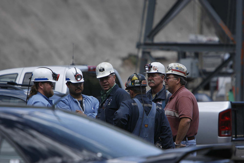 Huntington -gdgdgd Miners and rescue personnell near the entrance of the Crandall Canyon coal mine Wednesday.  Trent Nelson/The Salt Lake Tribune; 8.08.2007