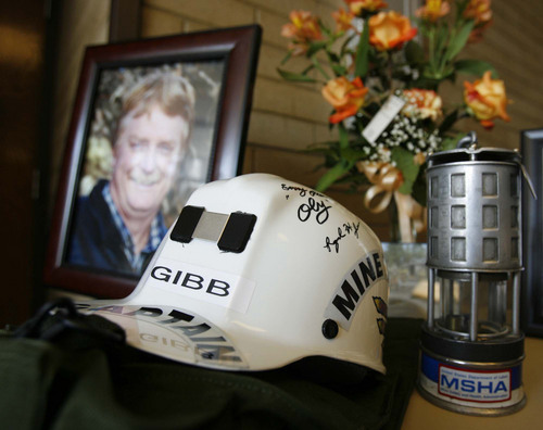 """Salina - Mine equipment and a portrait of Gary Jensen on display at the funeral for Gary """"Gibb"""" Jensen, held at the Salina LDS Stake Center. Jensen was killed with two others in the rescue and recovery operation at the Crandall Canyon Mine, where six men remain trapped. Trent Nelson/The Salt Lake Tribune; 8.22.2007"""
